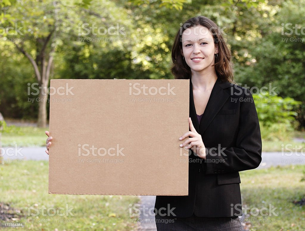 Young Woman Holds Cardboard Sign royalty-free stock photo