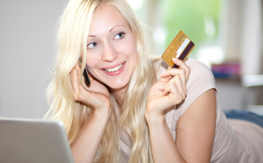 Young Woman Holds Credit Card Stock Photo - Download Image Now