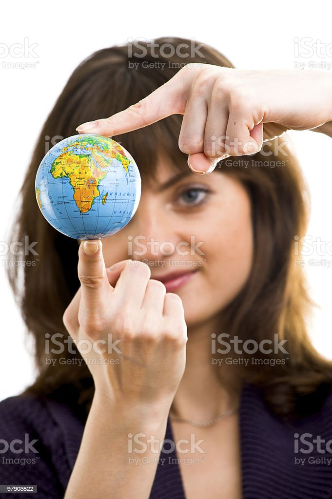 Young woman holds the globe in hands royalty-free stock photo
