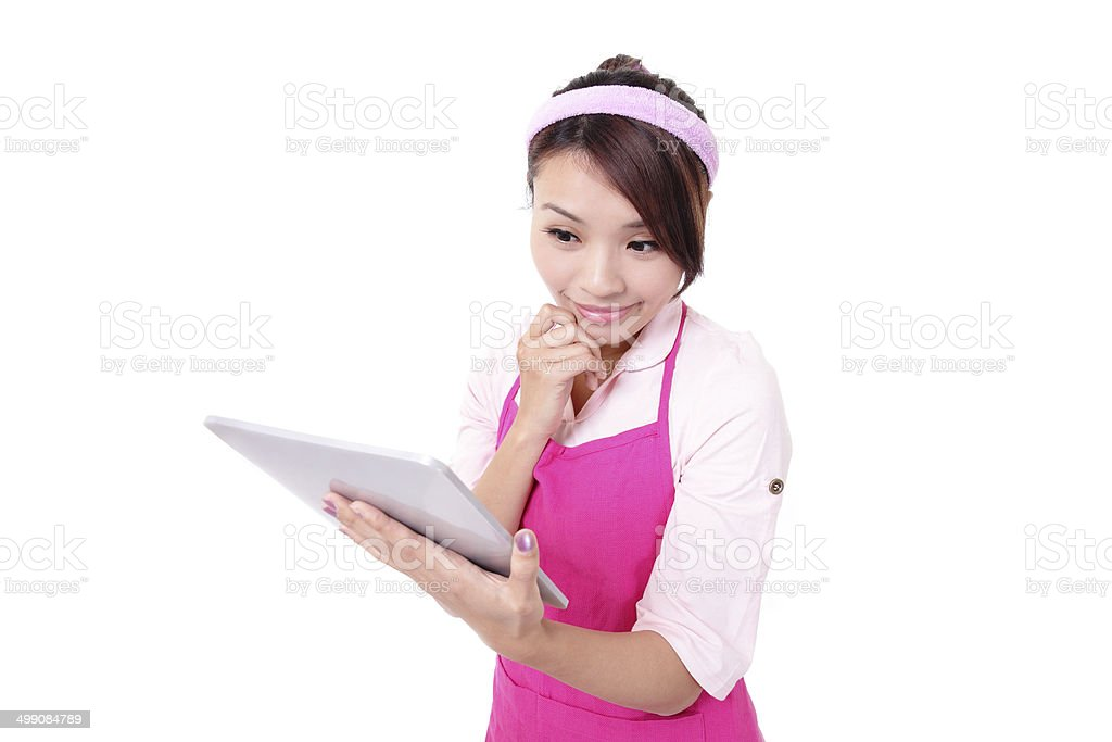Young woman housewife with tablet pc royalty-free stock photo