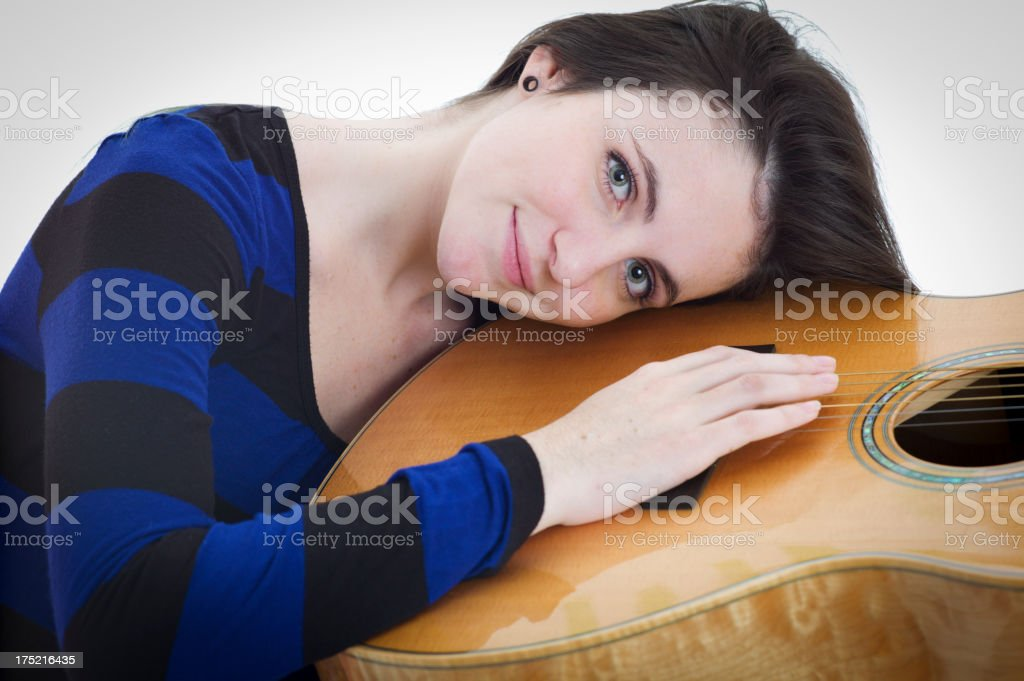 Young Woman Hugging an Acoustic Guitar. royalty-free stock photo