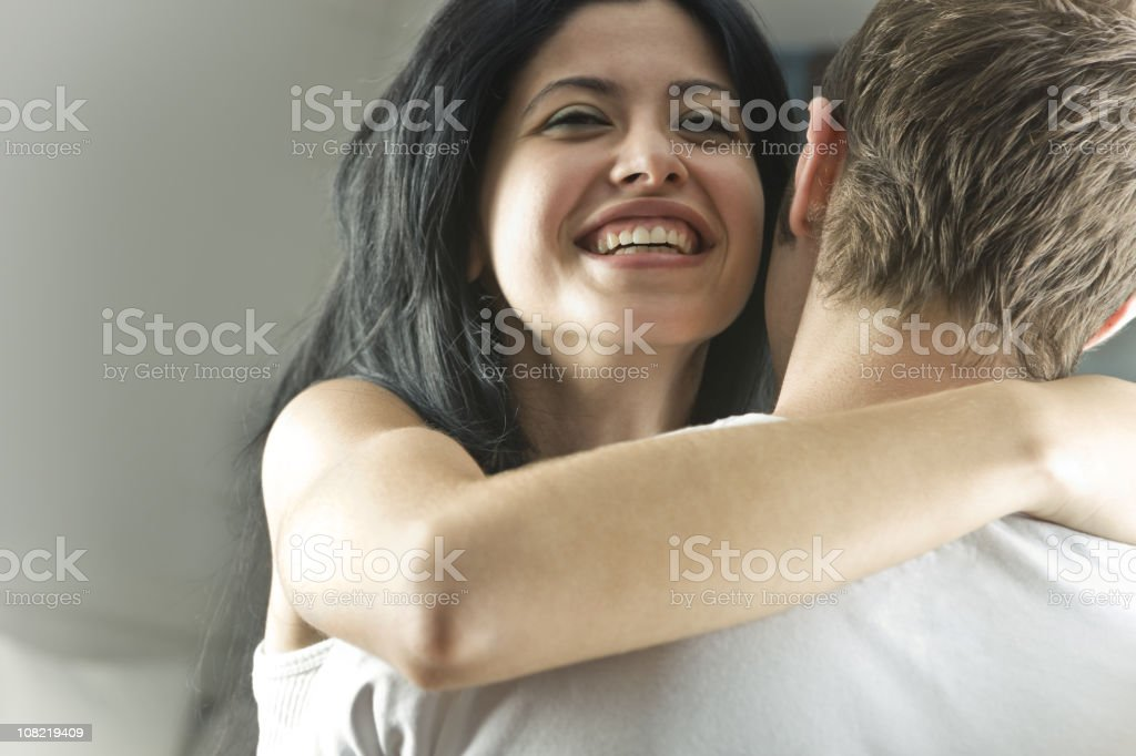 Young Woman Hugging Boyfriend royalty-free stock photo