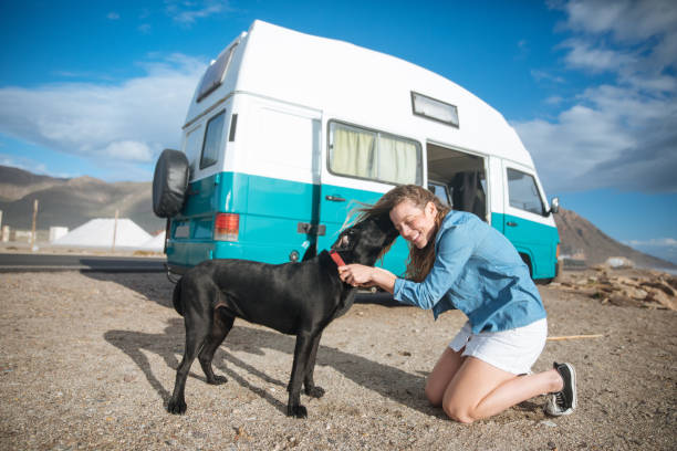 Young woman hugging her dog in front of a blue classic van in the picture id938291774?b=1&k=6&m=938291774&s=612x612&w=0&h=czr gorv1wxhjbx6l1a522fe2unchmd4bawdd4m hui=