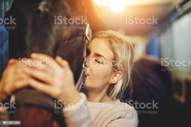 Young woman hugging her horse in stables before a ride picture id961362584?b=1&k=6&m=961362584&s=612x612&h=e7pm0ovab 4wc3riotuzdc5i6ivdpour7f6h5frgztq=