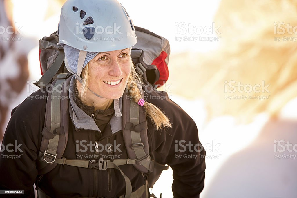 Young Woman Ice Climbing royalty-free stock photo