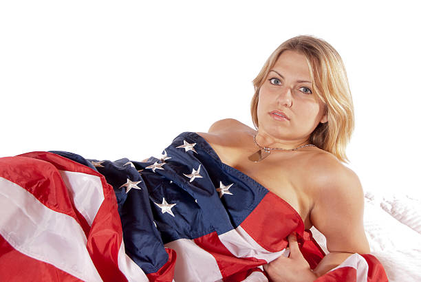 young woman implied nude American Flag stock photo