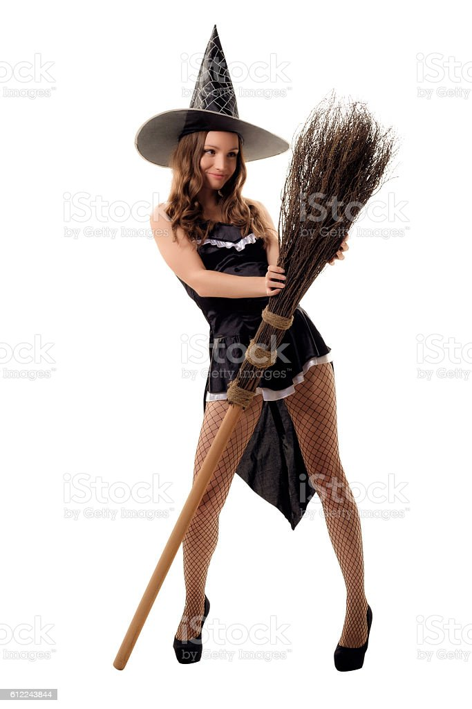Young Woman In A Black Halloween Costume Posing In Studio Stock