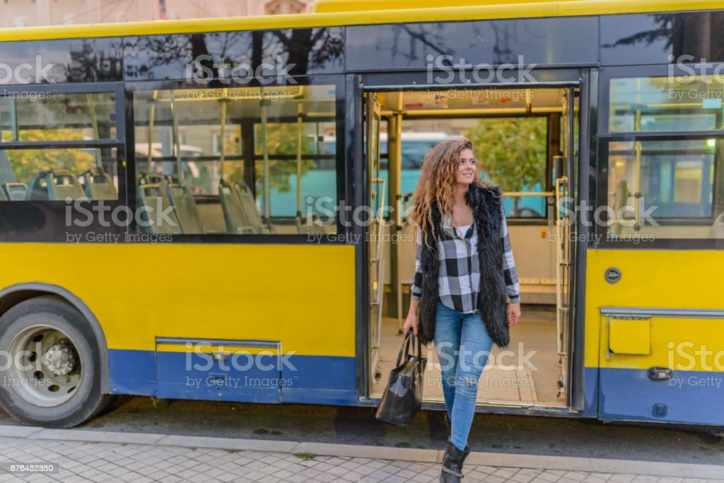 Young woman in a bus stock photo