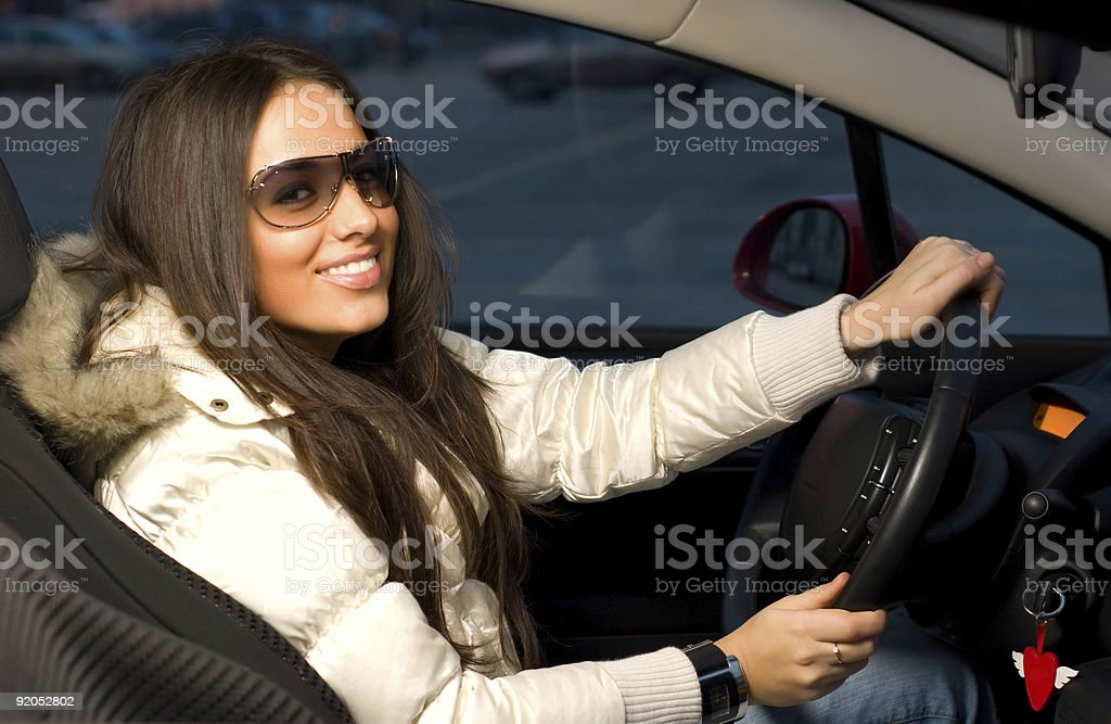 young woman in a car stock photo