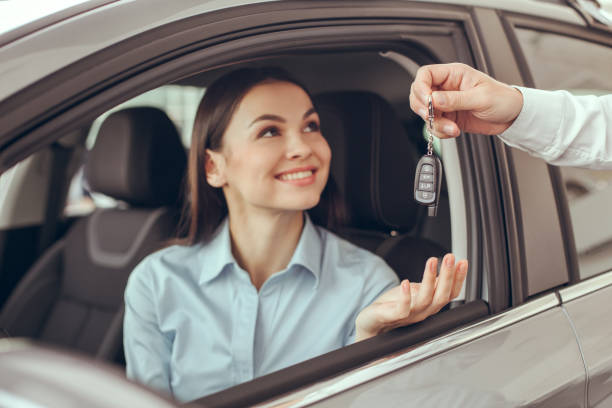 young woman in a car rental service test drive concept - used car selling stock pictures, royalty-free photos & images