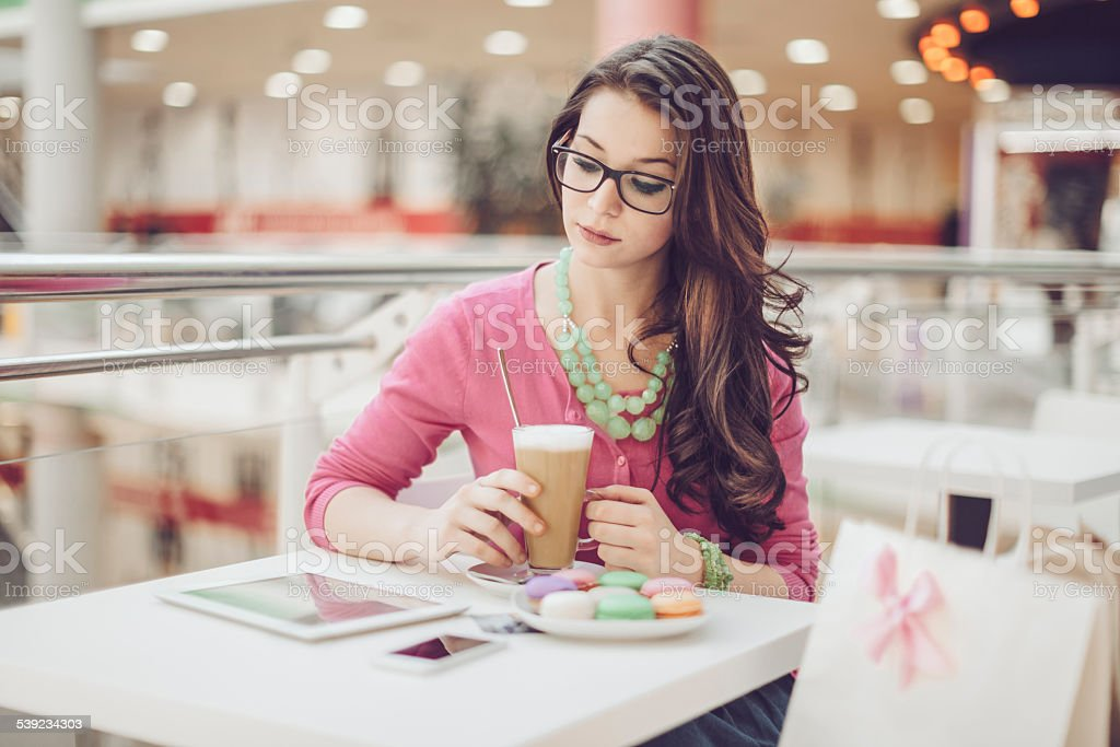 Young woman in a coffee shop royalty-free stock photo