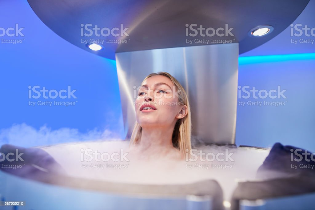 Young woman in a cryo sauna chamber stock photo