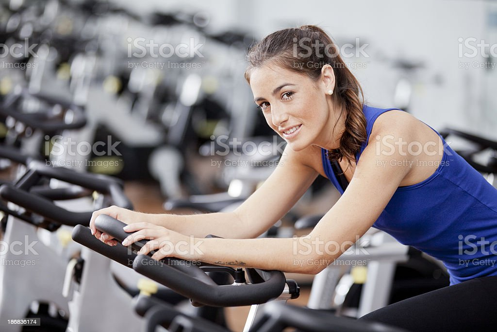 Young woman in a cycling class stock photo