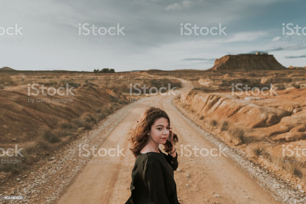 A young woman in a desert