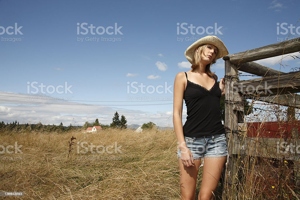 Young woman in a field stock photo