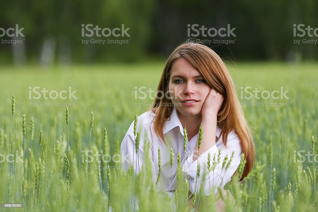 Young woman in a field royalty-free stock photo