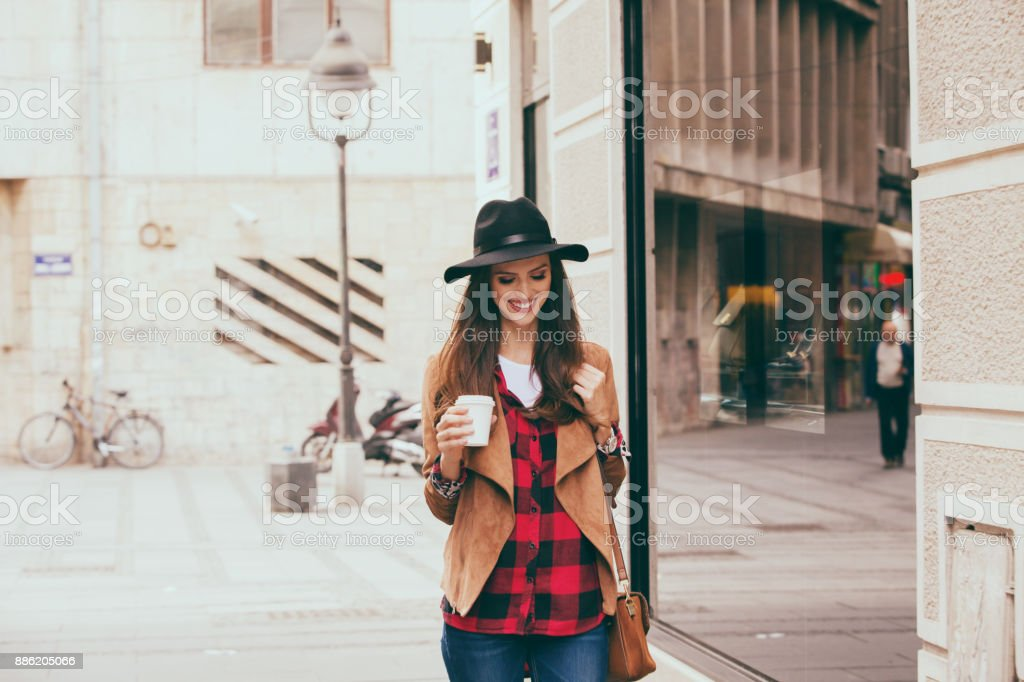 Young woman in a hurry going to work stock photo