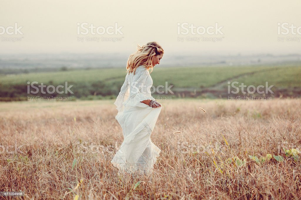 Young woman in a meadow stock photo