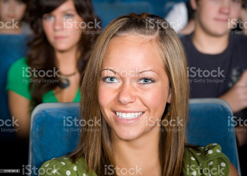 Young Woman in a Movie Theater royalty-free stock photo