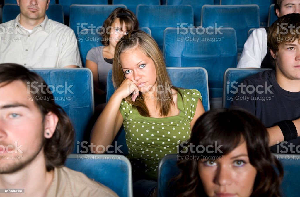 Young Woman in a Movie Theater stock photo