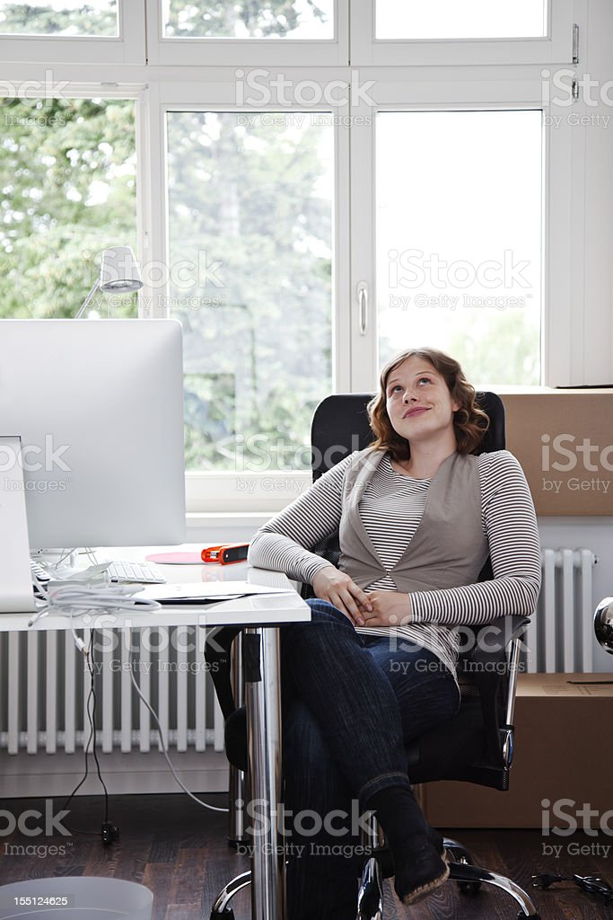 Young Woman in a New Office royalty-free stock photo