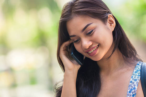 young woman in a phone call - philippines girl stock photos and pictures