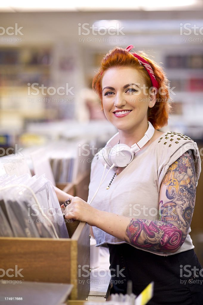 young woman in a record shop stock photo