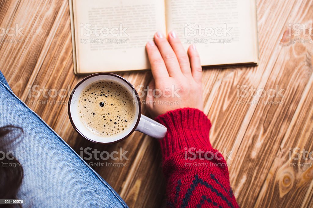 young woman in a red sweater holding cup of coffee foto stock royalty-free