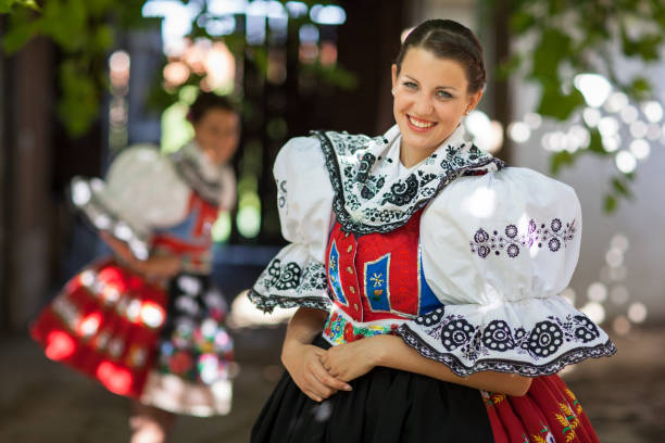young woman in a richly decorated ceremonial folk dress/regional costume Keeping tradition alive: young woman in a richly decorated ceremonial folk dress/regional costume (Kyjov folk costume, Southern Moravia, Czech Republic) moravia stock pictures, royalty-free photos & images