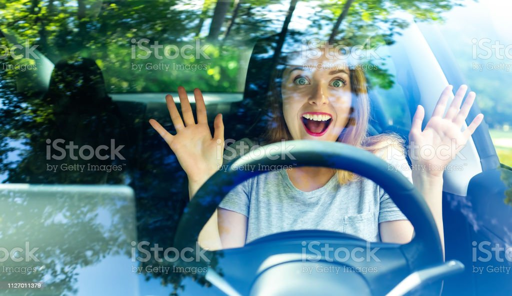 Young woman in a self driving car stock photo