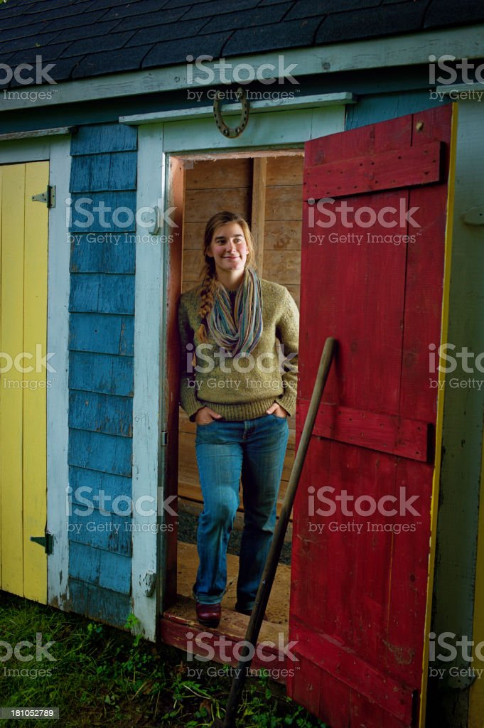 Young Woman in a Shed Doorway at Dusk. royalty-free stock photo