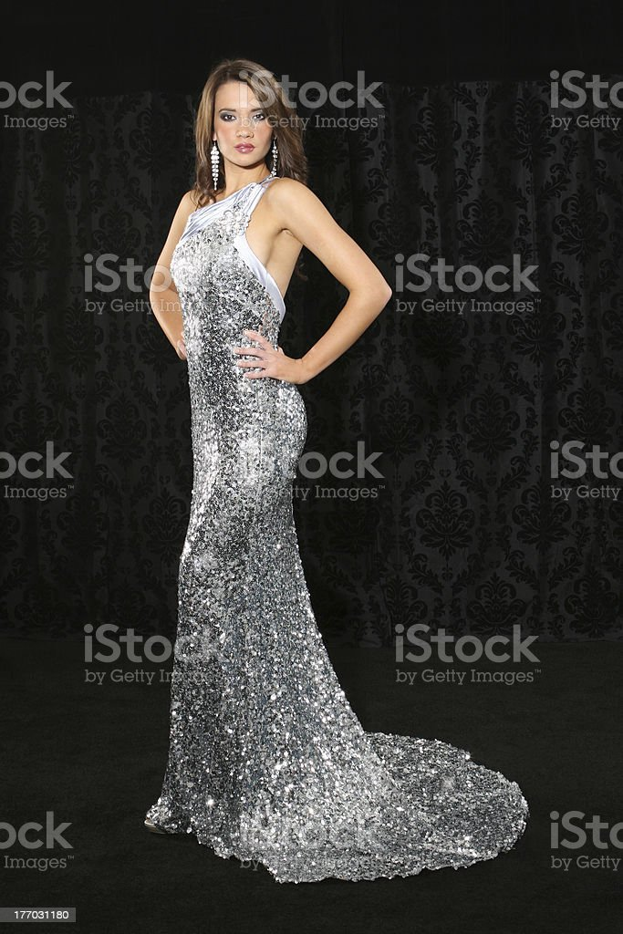 Young woman in a silver sequined dress stock photo