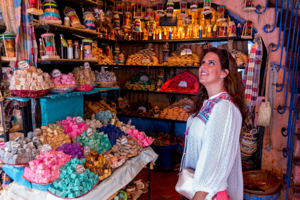 A young woman in a soap store in Chefchaouen in Morocco stock photo