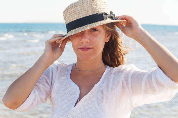 651da5ea7ace2 A Young Woman In A Straw Hat Fervently Laughing Against The Background Of  The Sea A Large Portrait The Concept Of A Young And Healthy Lifestyle Stock  Photo ...