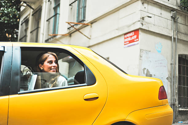 Young woman in a taxi after shopping stock photo
