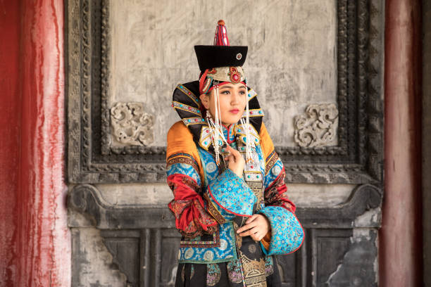 Young woman in a traditional Mongolian outfit. Young Mongolian woman in a traditional 13th century costume in a temple. Ulaanbaatar, Mongolia. independent mongolia stock pictures, royalty-free photos & images