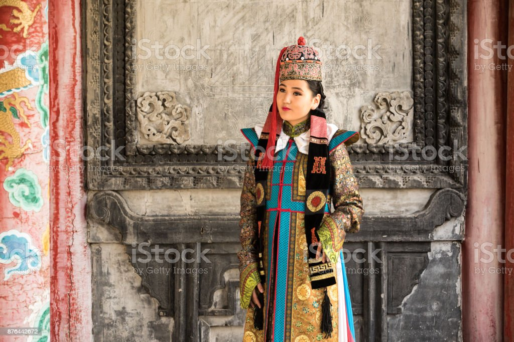 Young woman in a traditional Mongolian outfit. stock photo