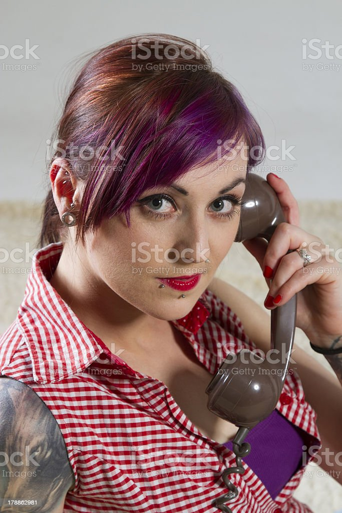 Young woman in a vintage look with telephone royalty-free stock photo