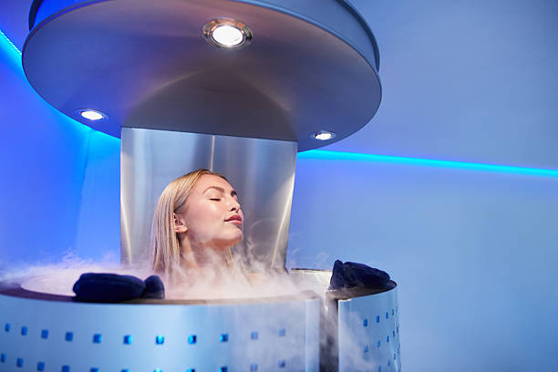 Young woman in a whole body cryo sauna Portrait of young woman in a whole body cryo sauna. Female getting cryo therapy at the cosmetology clinic. cryotherapy stock pictures, royalty-free photos & images