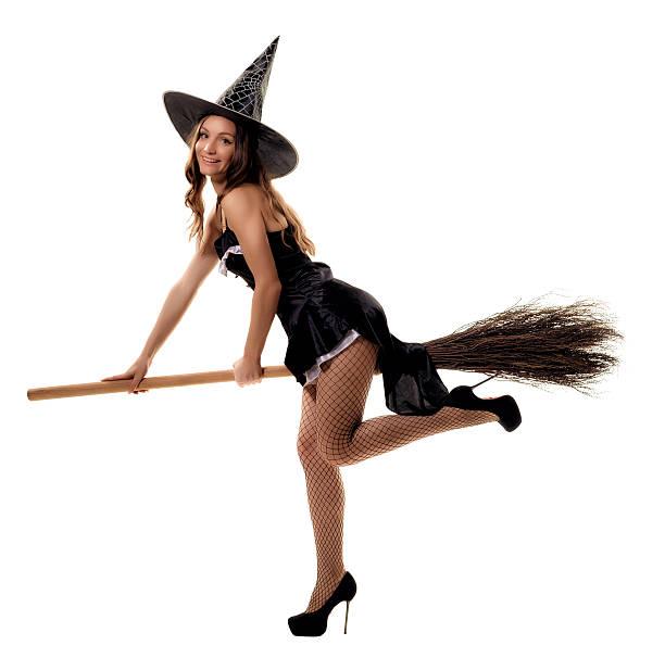 young woman in a witch costume posing in studio - damen rock kostüme stock-fotos und bilder
