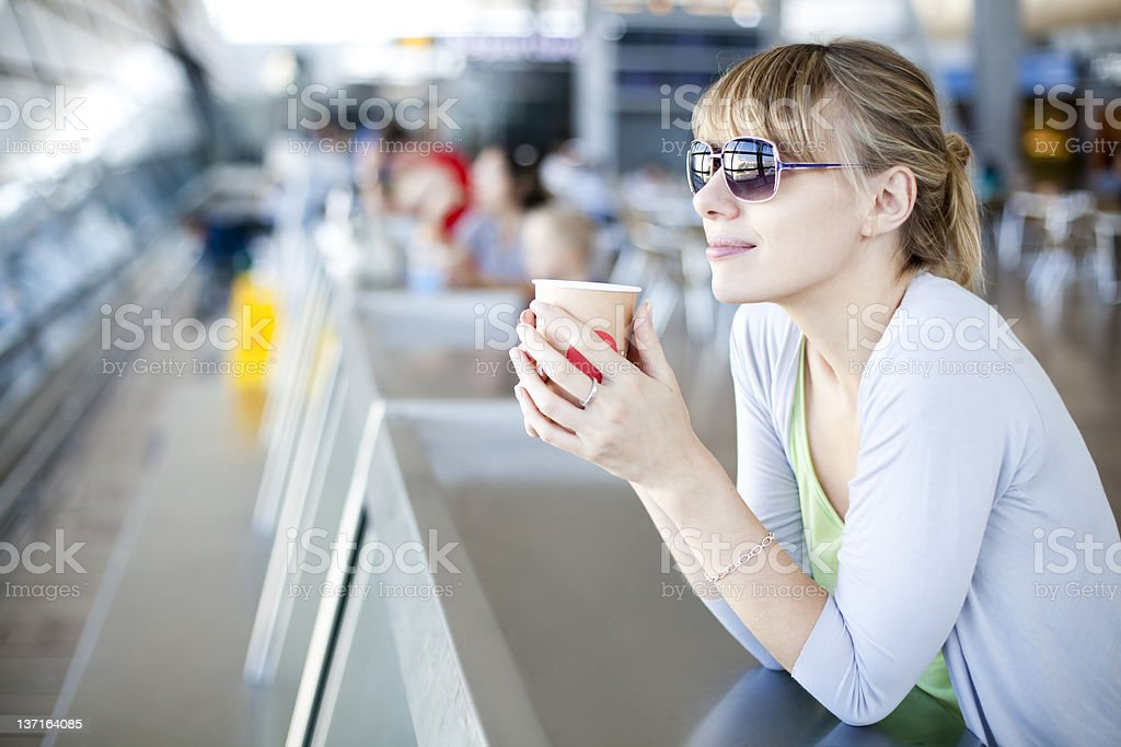 Young Woman In Airport Café stock photo