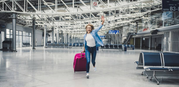 young woman in airport - getting on stock photos and pictures