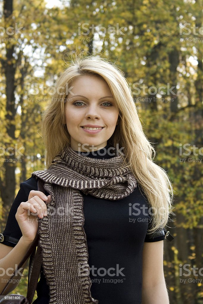 Young woman in autumn forest royalty-free stock photo