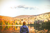 istock Young Woman in Autumn Landscape. 1278845976
