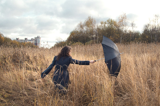 umbrella pulls out the wind from the hands of women