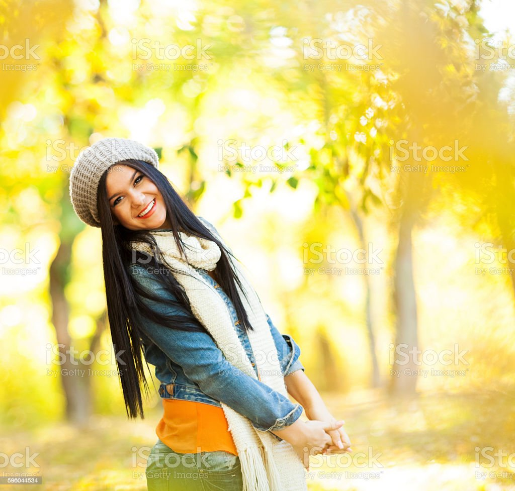 Young woman in autumn park royalty-free stock photo