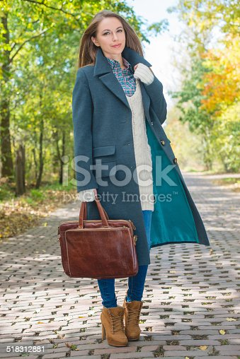 istock Young Woman in Autumn Season Attire at Pathway 518312881