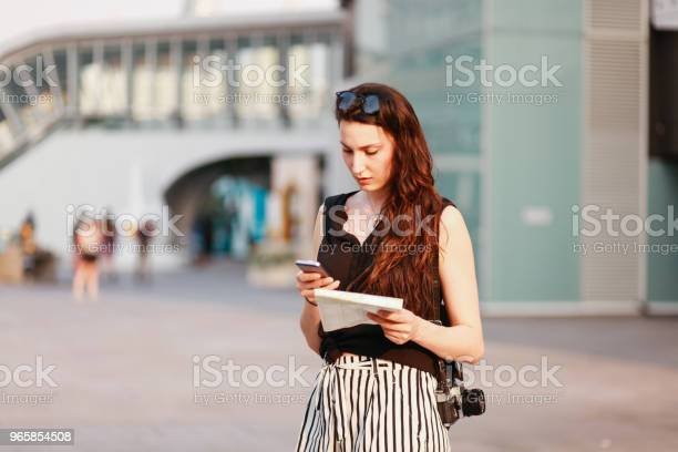 Young Woman In Bangkok Downtown District Texting On Her Cellphone Stock Photo - Download Image Now
