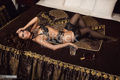 Young woman in beautiful lingerie on the bed