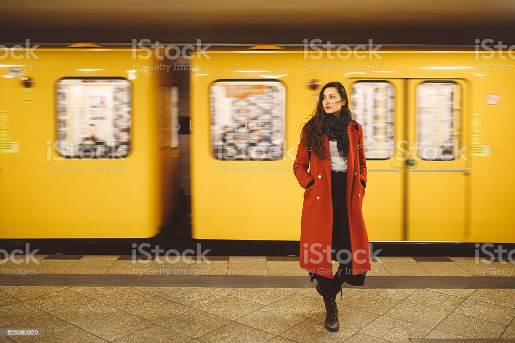 Young woman in Berlin subway station stock photo